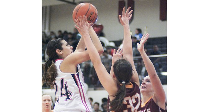 Tiana Perez (left) of the Lady Grizzlies attempts to shoot the ball past two Moses Lake defenders this past Friday.