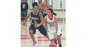 Sunnyside freshman Emilee Maldonado, who canned 13 points, works the ball past Shadle Park senior Shalise Hicks in last Friday's Regional semi-final game. Hicks ended up as the top scorer in the game with 25 points. Sunnyside, though, had five players in double figures, which accounted for the Lady Grizzlies' 84-73 shootout victory.