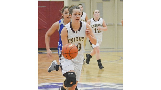 Lady Knight Annie Brouwer breaks away with the ball up court during Sunnyside Christian's State sectional game against the Tekoa-Oakesdale Nighthawks last Friday night.