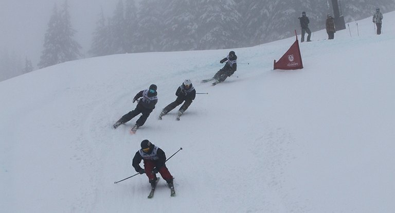 pattrick crompton leads a field of skiercross racers down the course on his way to winning a state title in the event Monday at Mt. Hood Meadows Ski Area.