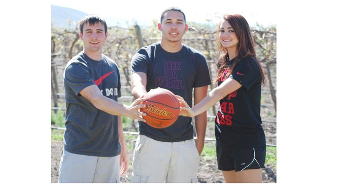 Cousins playing basketball together at CBC this season included (L-R) Brandon Oswalt, Jordan King and Lyndsay Oswalt.