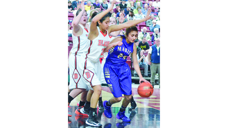 Soila Zaragoza, after securing an offensive rebound in the second half of the game last night, gains control as the Borderites attempt to block her out.