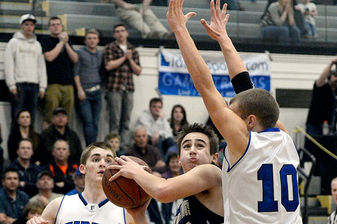 With 20 seconds left in Grangeville's semifinal game against Firth, junior Jake Stokes drove for a layup attempt and drew this two-handed foul from Firth's Braydon Adams. The shot found the iron and bounced away, but Stokes canned both free throws to keep Grangeville's 2A title hopes alive for one more possession. Needing a three-pointer to tie it at 44 with less than 10 seconds to go, Stokes ferreted out a rebound, dribbled out to the arc and put up a triple try that barely missed.