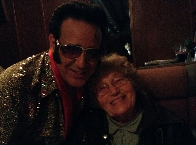 Dorothy Phelps meets Elvis on the Mt. Hood Railroad Dinner Train in February. Hawks Ridge's Senior Wish program helped Dorothy and her family attend the event which included a special musical performance from Elvis.