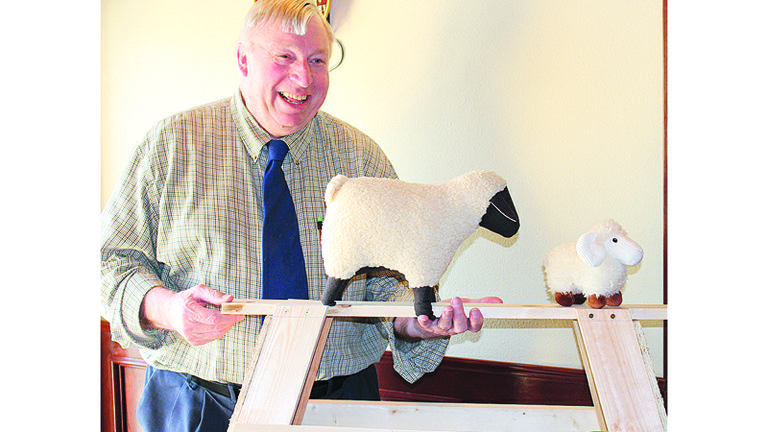 "Jake Van Pelt holds up a model of the sawhorse which will be provided to this year's ""Flock to the Fair"" sheep decorators. ""Contestants must supply their own sheep,"" he said. The decorated sheep contest deadline is July 1, and is sponsored by the Yakima Valley Fair and Rodeo Foundation."