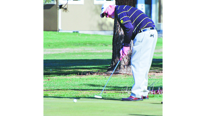 Scott Galbraith, the PGA club pro at Sunnyside's Black Rock Creek Golf Course, takes dead aim at the cup on the 10th green this past Saturday. Galbraith and Mt. Adams Country Club pro Rich Farrell hosted the 2014 kick-off tournament for Yakima Valley golfers this past weekend.