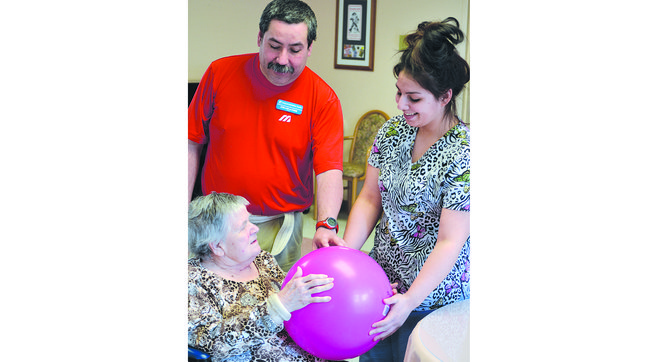Adele Symonds, a Prestige Care resident in Grandview, enjoys some activity time with staff members Jose De La Torre and Jennifer Garcia.