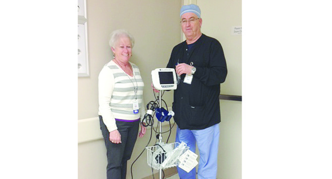 Certified Registered Nurse Anesthetist Patrick Corbett and Sunnyside Community Hospital Auxiliary President Debbie Amos display the new Glidescope that was recently obtained for the hospital's anesthesia department. The fiber optic, illuminated scope was purchased with proceeds raised at last November's Festival of Trees event, hosted by the Sunnyside Community Hospital Auxiliary. The Glidescope helps visualize the airway of patients with compromised airways. The scope has already been used several times to help with patient intubations.