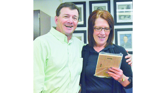 Mabton High School wrestling coach John Kilian is presented one of two awards by Sue Sartain at this past Monday's Mabton School Board meeting.. He was named SCAC West Coach of the Year and Regional Coach of the Year for 2013-14.