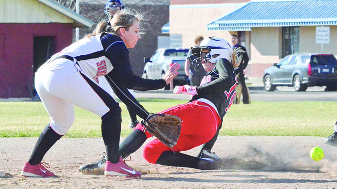 A Riverview base runner slides into second before Sunnyside's Shawna Santini can scoop up the ball from the dirt for the tag out.