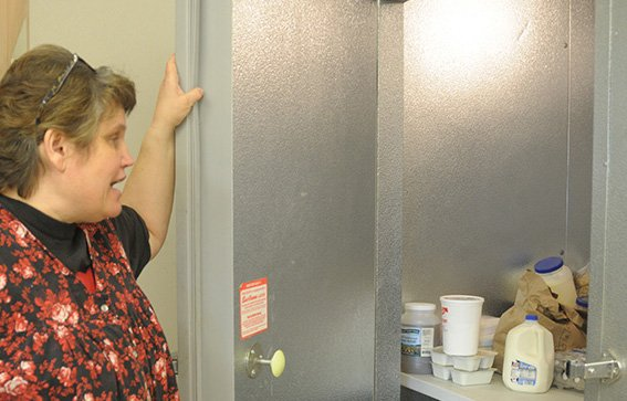 Senior meals cook Joyce Forsmann shows the new cooler at the Grangeville Senior Citizens Center.