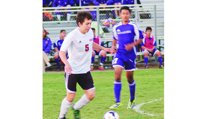 Sunnyside's Jacob Meza (5) maintains control of the ball during the Grizzlies' 2-0 league-opening win over Wenatchee last night.
