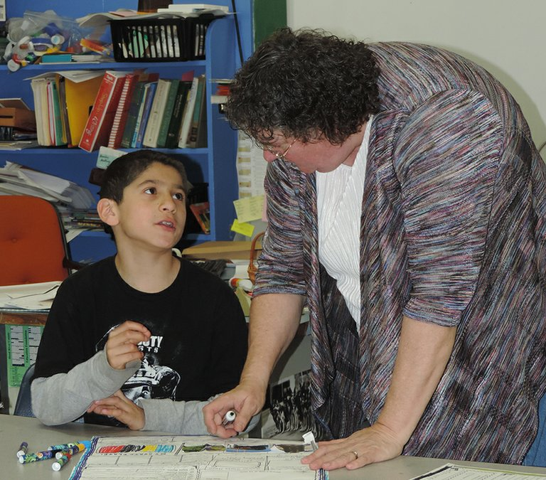 Laurie Wheeler works with Joaquin Gardea on his U.S. states project.