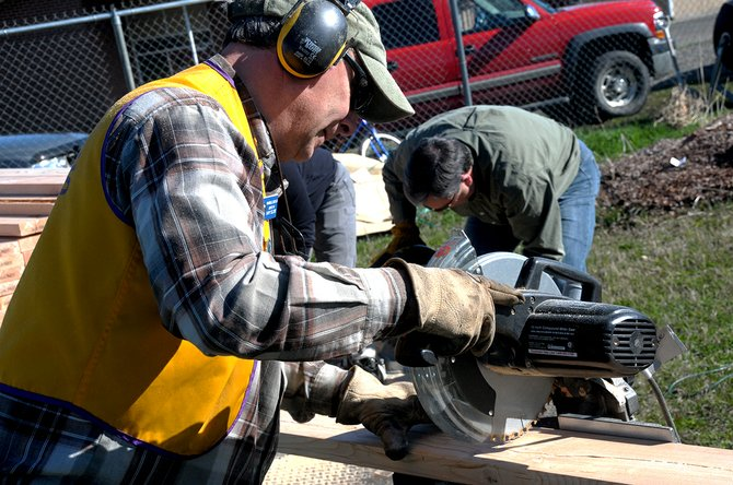 Grangeville Lions member Garry Seloske was busy sawing and working with other club members Saturday morning, April 12, at the Camas Prairie Food Bank lot. The men were cutting boards to build 16 beds for the community garden.