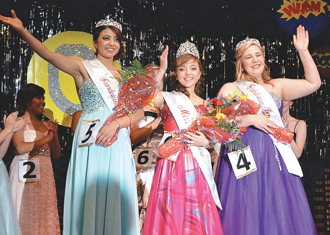Waving to those gathered at this past Saturday's 2014-15 Miss Grandview Pageant are newly crowned co-Princess Marissa Garza, Miss Grandview Cecilia Coronado and co-Princess Taylor Colson (L-R).