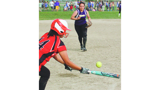 Lady Viking Cassidy McCallum charges to collect a bunt hit by the Zillah batter in last night's doubleheader at Mabton.