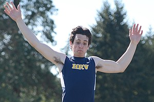 Parker Irusta jumps to a first-place finish Tuesday in the long jump.