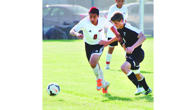 Sunnyside's Luis Licona (L) hustles after the ball as University's Diego Morales gives chase. Licona scored the final Grizzly goal in last night's 5-1 win.