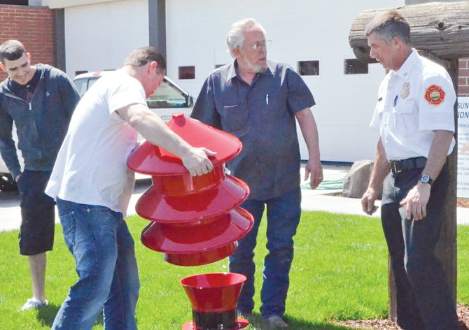 Once a weathered silver colored unit, the former Sunnyside Fire Department siren is now a bright red. The siren was delivered to the Sunnyside Fire Department Monday afternoon, thanks to the efforts of Advanced Collision Repair Center staff who did the siren restoration. Pictured are (L-R) Carlos Donan, Jaime Yates and Ron Hochhalter of Advanced Collision Repair Center and Sunnyside Fire Chief Aaron Markham.