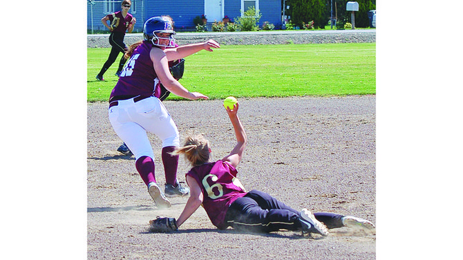Sunnyside Christian's Jenna DenHoed (6) attempts to make a play in catching a Kittitas player in a rundown in yesterday's regular season finale. DenHoed had two base hits in the opening game Monday while driving in two runs, and lashed an RBI double in the second game loss to Kittitas.