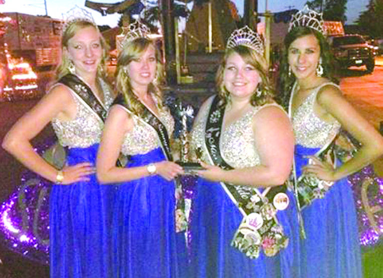 The Miss Sunnyside Court was awarded the Moses Lake Chamber of Commerce trophy at the Moses Lake Moonlight Parade held last Saturday. Pictured with their trophy are (L-R) Princesses Leah Diddens and Ashley Davis, Miss Sunnyside Alyson Spidle, and Princess Tiana Perez.