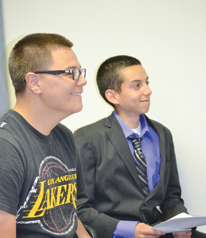 Mabton Jr./Sr. High School eighth graders Diego Garza (L) and Nicholas Mejia propose the Loving Mabton Project to the Mabton City Council Tuesday night. The council was receptive to the teens' ideas of improving the city.