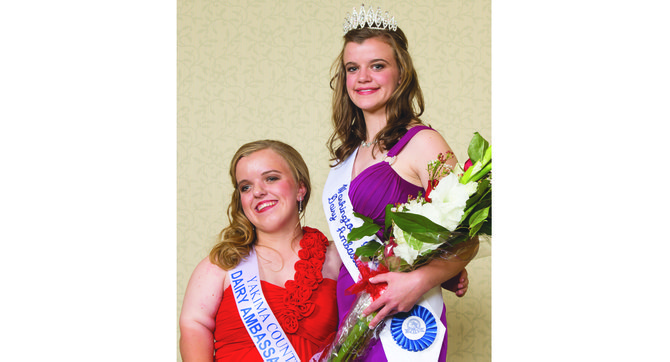Yakima County Dairy Ambassador Katie Hutchins and newly crowned 2014-15 Washington State Dairy Ambassador Janis DeJager pose for a photo following coronation ceremonies last Friday.