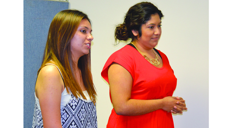Yarelly Gomez (L) and Vanessa Sanchez present their plans for summer youth programs in Mabton. They are working with the city as summer interns from UW. Gomez is a 2013 graduate of Sunnyside High School and Sanchez a 2013 graduate of Mabton High School.