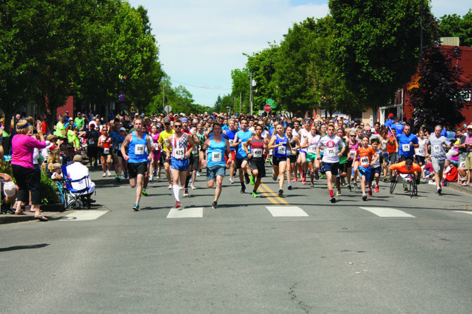 Runners take off at the start of the Monmouth-Independence Mini-Marathon on Friday. The 2.6-mile race ended in downtown Independence.