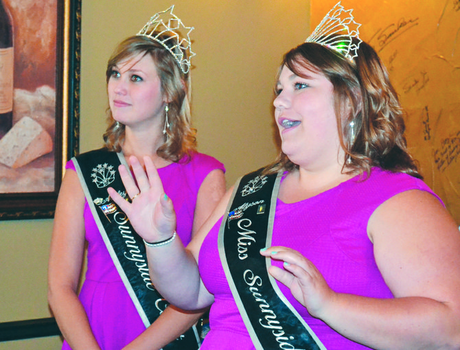 Miss Sunnyside Alyson Spidle (R) and Princess Ashley Davis reflect on the court's reign over the past year during a presentation to the Sunnyside Kiwanis Club.