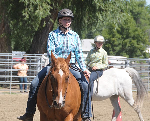 Nichole Blackmer and Molly VanSteenwyk, both of Grangeville and members of Hold Your Horses 4-H Club, participate in the bareback equitation portion of the Idaho County Horse Show held Saturday, July 26, in Grangeville.