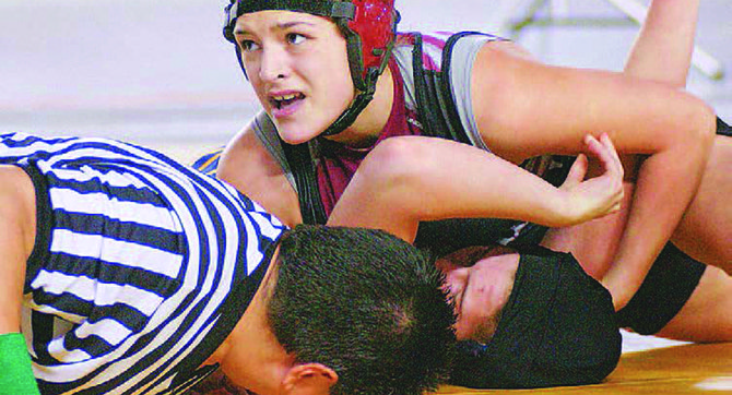 Lady Greyhound Desiree Zavala (130 lbs.) pins Maria Horton of Kelso in the State finals this past February. Zavala won her second national title in a span of three months during an event last month at Fargo, N.D.