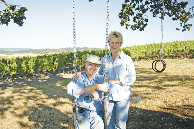 Joe Allan, left, and Karen Saul are the owners of Andante Vineyard in Dallas, one of about a dozen attempting to designate the area near Perrydale as a sub-appellation.