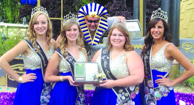 "The Sunnyside community float, which sports an ""Egyptian Treasures"" theme, earned first-place honors last Saturday at the Moxee Hop Festival Parade. Pictured from left are Sunnyside princesses Leah Diddens and Ashley Davis, pharoah float driver Mark Diddens, Miss Sunnyside Alyson Spidle and Sunnyside princess Tiana Perez."