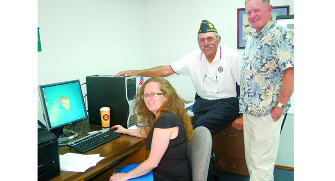 With the installation of new office equipment, Sunnyside American Legion Post 73 will now be able to help area veterans with service claims in a more timely manner, according to Post Commander Troy Monholland (center). Pictured in the new office with Monholland are DeLessa Restucci, post adjutant; and post finance director Nate Bridges, who donated the office space for the post's use.