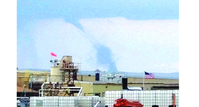 Local residents had the opportunity to take in a rare sight last night, Wednesday, when a tornado-resembling funnel cloud was spotted in the sky. Pictured in the foreground is the Seneca Foods plant in Sunnyside.