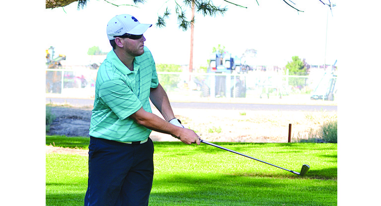 Sunnyside's Andrew Schutt takes a practice swing before taking a shot in day-one action last Saturday in the 58th annual Banana Belt. Schutt went on to capture top honors, carding rounds of 72-71 for a 1-under-par 143.