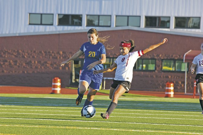 Central senior Alexis Orozco (9) fights for a loose ball against Cottage Grove on Thursday.