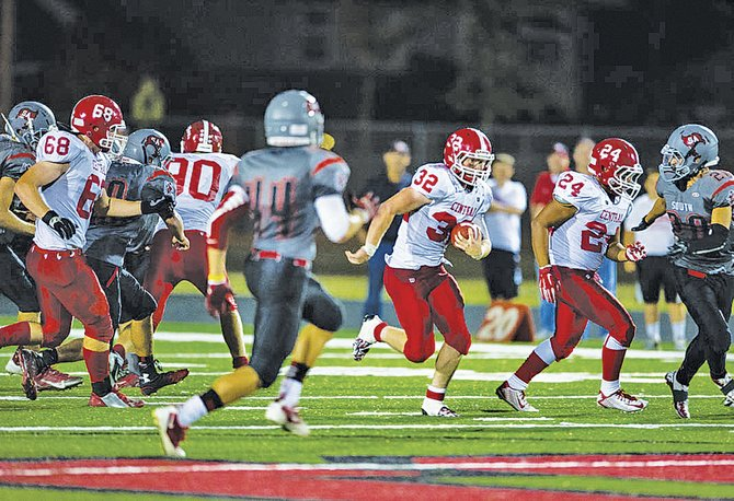 Central running back Wes Riddell (32) helps Central gain more than 550 yards of total offense against South Albany.