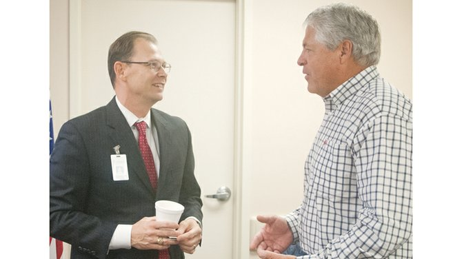 Sunnyside Community Hospital CEO John Gallagher (L) chats with Sunnyside Daybreak Rotarian Ted Durfey this morning following Gallagher's update on the hospital's recent shifts in mission and its expansion progress. Gallagher announced the hospital plans to open a new urgent care clinic in Prosser.