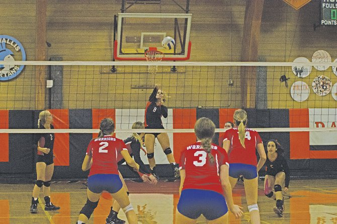 Dallas' Danielle Remington (8) goes up for an attempted kill against Lebanon.