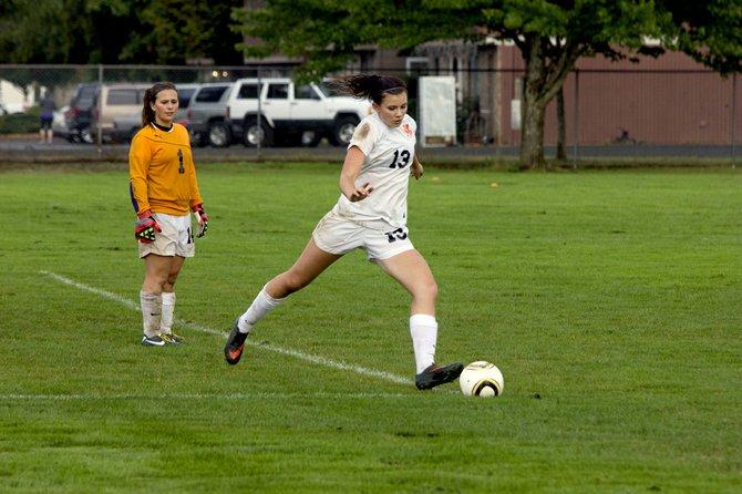 Dallas defender Katie Senger kicks a ball up field.