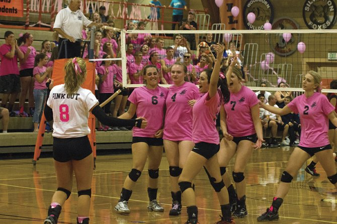Danielle Remington, Cambria Blair, Hailey Miller, Reagan Davis, Briana Classen and Amanda Dankenbring (from left) celebrate their 25-23, 18-25, 25-17, 25-16 victory over Central on Monday evening.