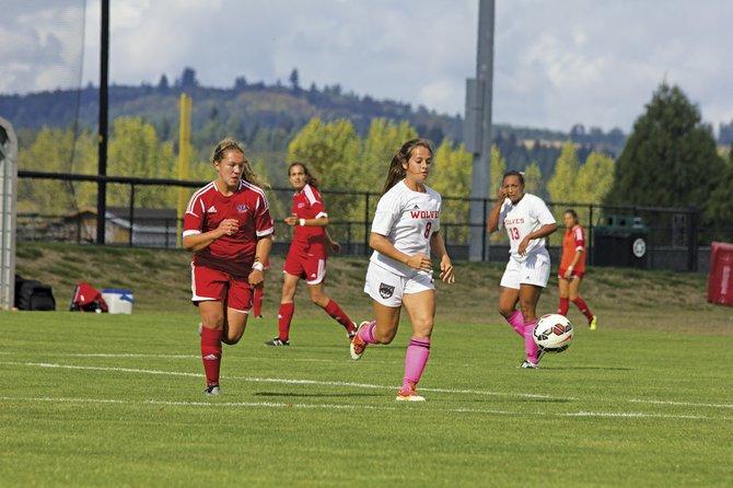 Sophomore midfielder Maria Konyn (8) advances the ball up field against Simon Fraser on Saturday.
