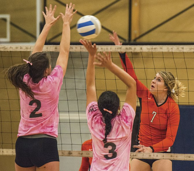 Dallas' Briana Classen (7) goes up for a block against Corvallis on Oct. 14.