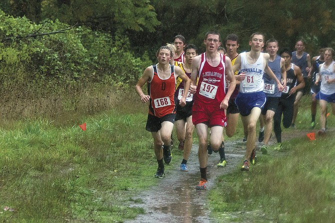Dallas junior Jesse Stuhr (168) attempts to pass a pack of runners during the rainy Mid-Willamette Conference Championships on Oct. 22.