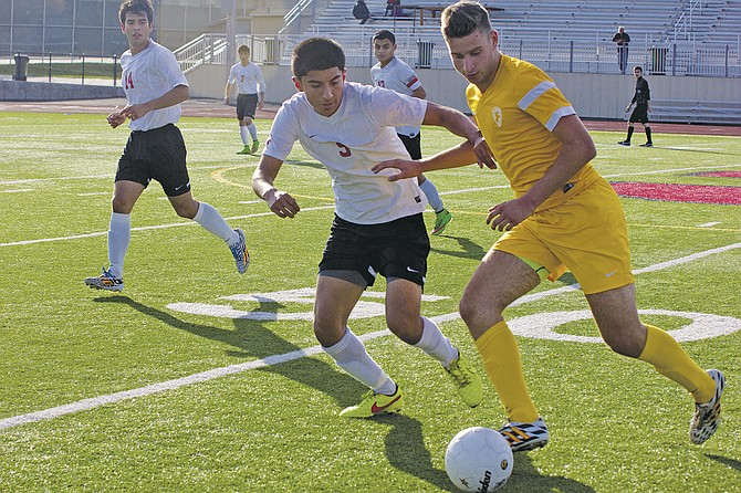 Central's Eddie Carrillo challenges for a ball against Crescent Valley on Thursday.