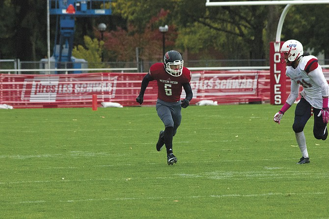 Western Oregon receiver Paul Revis attempts to catch up to a pass against Simon Fraser on Saturday.