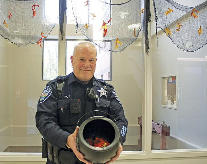 Independence officer Pete Roy will be passing out candy at the police station, one of the city's trick-or-treat stops.