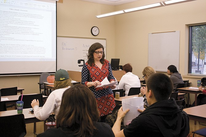 Tandy Tillinghast-Voit, Extended Campus writing teacher, hands out assignments at Chemeketa's Dallas campus.
